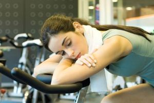 Woman Resting on Exercise Bike